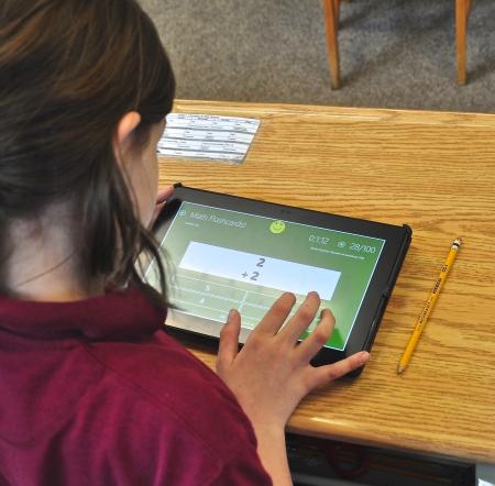 Grade school student using a tablet